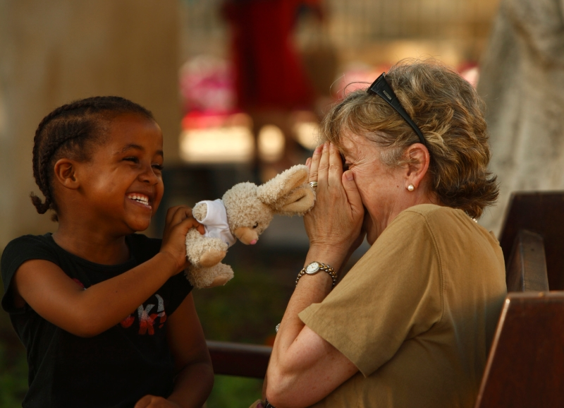 A child uses her soft toy to play with a Maltese woman during the World Refugee Day Festival at the Upper Barrakka Gardens in Valletta June 23, 2012. According to the majority of Maltese who responded to an EU-wide survey, immigrants do not offer any added value to the local economy or culture, local media reported.