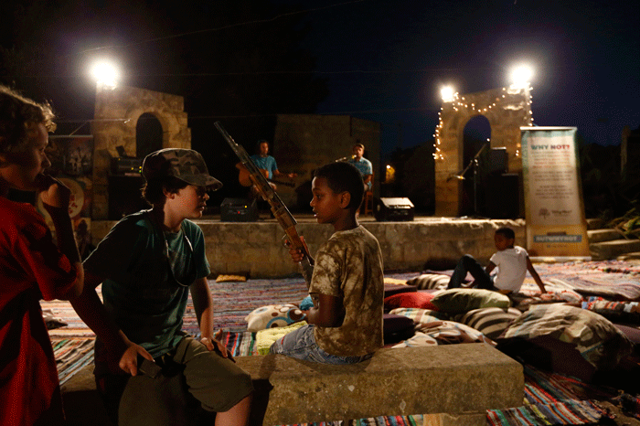 An African child talks with Maltese children during a musical integration party at the Peace Lab complex in Hal Far, outside Valletta, June 25, 2013. Run by Franciscan friars, the Peace Lab is home to around fifty adult migrants and their children, all of whom had been rescued by the Maltese Armed Forces while attempting to reach European soil from Africa.