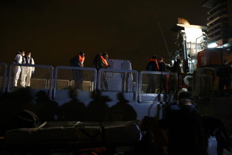 Migrants disembark from an Armed Forces of Malta (AFM) vessel at the AFM Maritime Squadron base at Haywharf in Valletta's Marsamxett Harbour, late March 20, 2014.  90 migrants claiming to be from Somalia were rescued by the AFM some 25 nautical miles off the Maltese islands when their boat ran into difficulties, according to army sources.  REUTERS/Darrin Zammit Lupi (MALTA)
