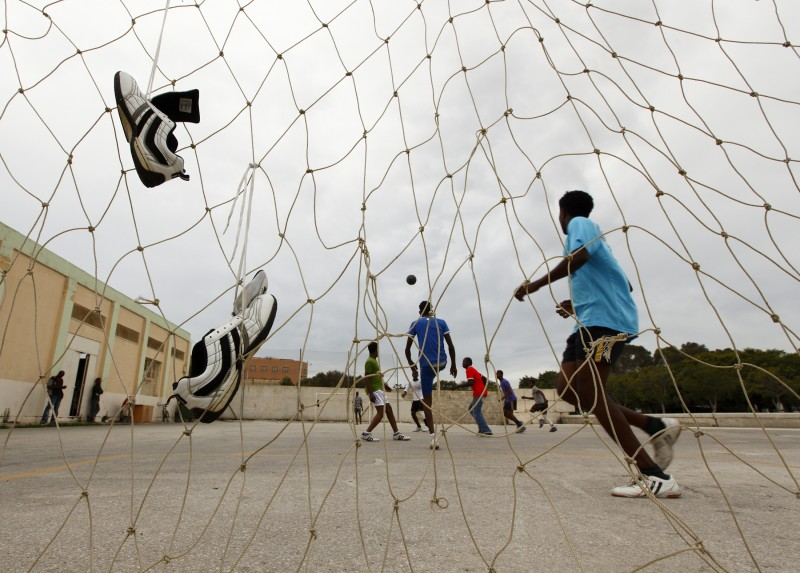 African immigrants play football at the Marsa Open Centre in Marsa in Valletta's Grand Harbour May 29, 2010.