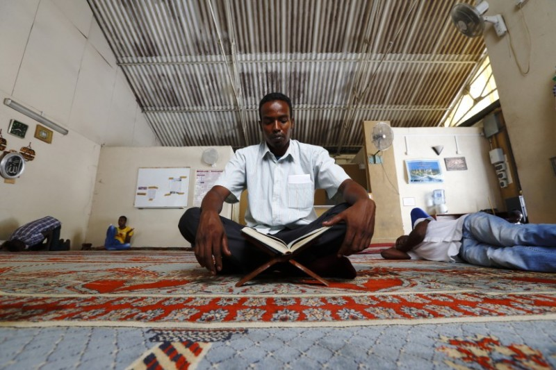 Mubarak Mahmud, a Somali asylum seeker, reads the Koran in the mosque at the Marsa Open Centre in Malta during Ramadan on August 2, 2013. The Marsa Open Centre houses around 500 male residents from 19 different countries in Sub-Saharan Africa.