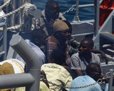 African migrants sit on the deck of an Armed Forces of Malta (AFM) patrol boat after arriving at the AFM Maritime Squadron base in Valletta's Marsamxett Harbour July 20, 2014. 83 migrants were rescued by a freighter after they were found to be in distress and were then transferred to the Maltese patrol boat, according to local media.