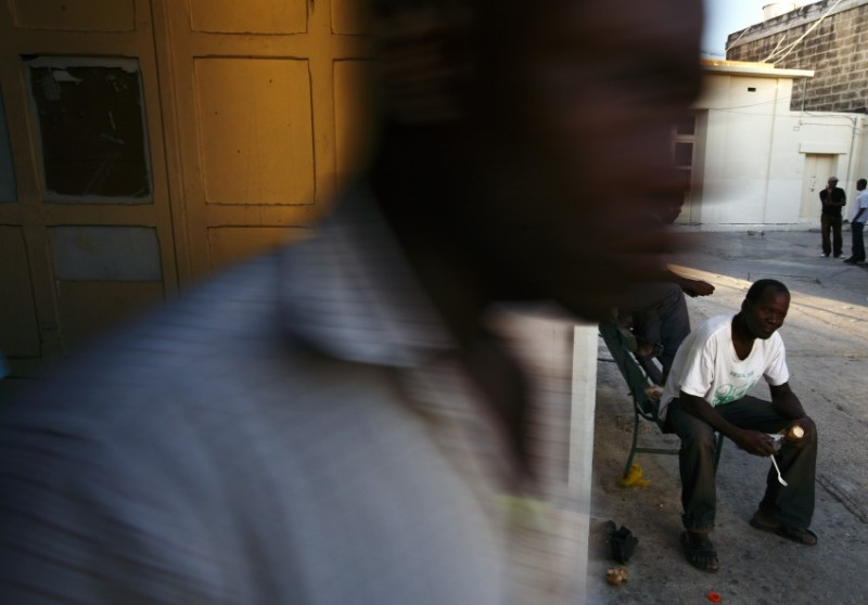 An African man eats his meal during Eid al-Fitr celebrations to mark the end of Ramadan at the Marsa Open Centre for Refugees and Asylum Seekers in Marsa in Valletta's Grand Harbour September 10, 2010.