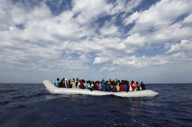 106 sub-Saharan Africans on board a rubber dinghy wait to be rescued by the NGO Migrant Offshore Aid Station (MOAS) off the Libyan coast October 4, 2014. MOAS, a privately-funded humanitarian initiative, began operating at the end of August and has since assisted in the rescue of some 2,200 migrants crossing from Libyan shores towards Europe.